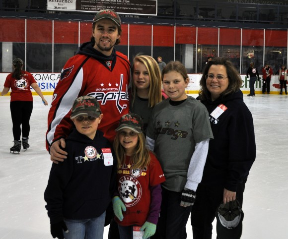 Washington Capitals defenseman Matt Niskanen poses for a photo with a group of skaters. Niskanen, alongside Capitals defensemen John Carlson, Jack Hillen and Brooks Orpik, hosted a skating party at Kettler Capitals Iceplex on Feb. 24 for children and adults who have found healing through TAPS. TAPS is a nonprofit organization that provides comfort and care for anyone who is grieving the death of someone who died while serving in the military. (Photo Courtesy of Washington Capitals)