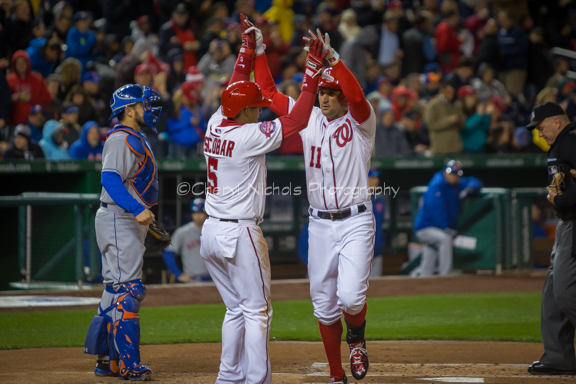 Escobar congratulates Ryan Zimmerman after hitting a 2-run homer.  Washington Nationals defeated the New York Mets 2-1 at Nats Park on April 8, 2015 after a rain delay (Photo by Cheryl Nichols/District Sports Page)