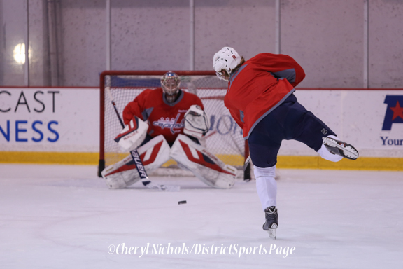 Backstrom takes a shot on Peters - Caps Game Day Practice at Kettler Iceplex before Playoff Round One, Game One,, 4/15/2015 (Photo by Cheryl Nichols/Distict Sports Page)